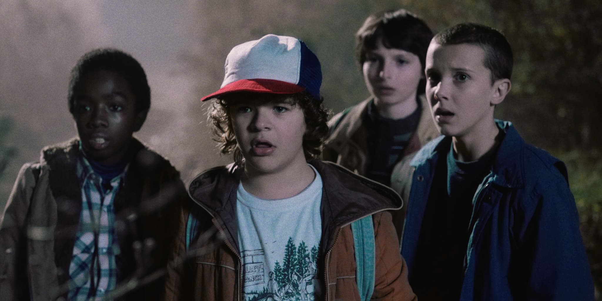 The Boys of Stranger Things with the myserious Eleven